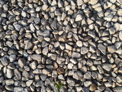 Natural stone pebble material texture background. stone background, dark gravel pebbles stone texture