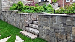 Natural stone steps and retaining wall in the garden.