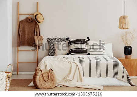 Natural style bedroom with king size bed and monochromatic decorations #1303675216