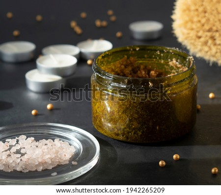 Natural sugar scrub. Anti cellulite brush with body scrub for perfect skin. Spa and wellness concept. Scrubbing body. Body scrub glass jar. Homemade cosmetic for peeling and spa care.