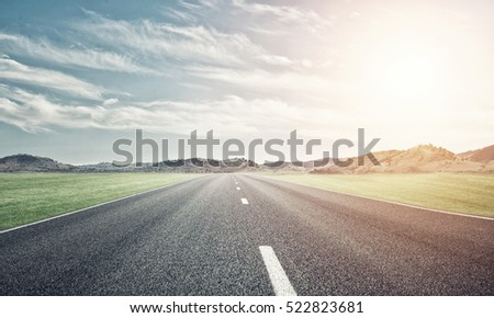 Natural summer landscape with asphalt road to horizon #522823681