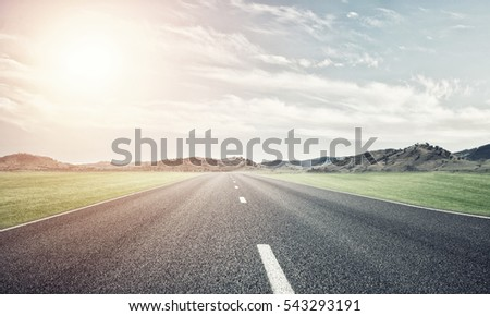 Natural summer landscape with asphalt road to horizon #543293191