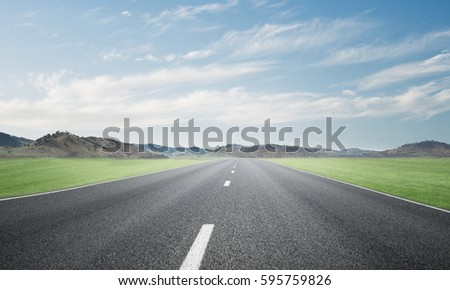 Natural summer landscape with asphalt road to horizon #595759826