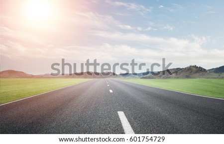 Natural summer landscape with asphalt road to horizon #601754729