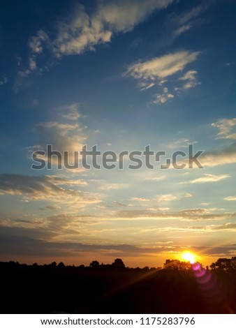 Natural Sunset Sunrise Over Field Or Meadow. Bright Dramatic Sky And Dark Ground. Countryside Landscape Under Scenic Colorful Sky At Sunset Dawn Sunrise. Sun Over Skyline #1175283796
