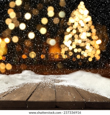natural table of snow and xmas tree