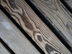 natural textured diagonal boards with sand - wooden light background