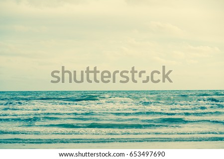 Natural tropical sea and beach with windy wave in Thailand. Retro filter #653497690