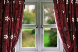 Natural view from window with drapes