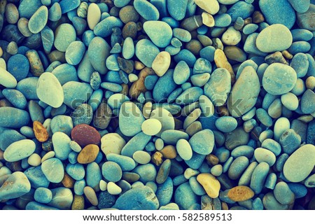 Natural vintage colorful pebbles background - Shutterstock ID 582589513
