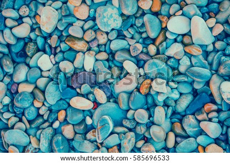 Natural vintage pebbles background in trendy blue color - Shutterstock ID 585696533