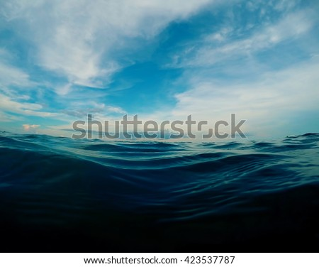 Natural water background, experimental color, Summer beach landscape sea water, Dark blue sea water look through, summer vacation on the beach, seaside view to sea and cloud, turquoise sea shore life