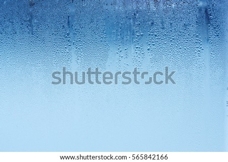 Natural water drops on glass, window with condensation, strong, high humidity