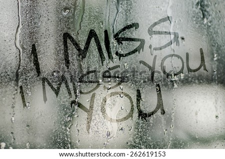 natural water drops on glass window with the text \