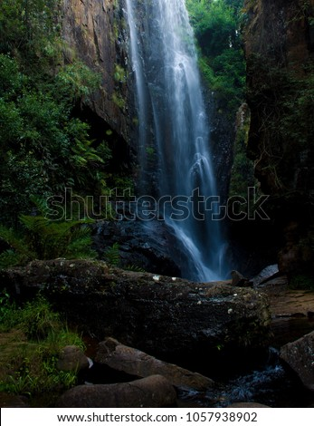 Natural waterfall surrounded by beauty #1057938902