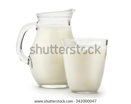 Natural whole milk in a jug and a glass isolated on a white background closeup #342000047