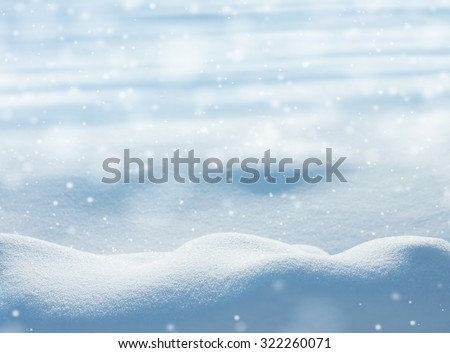 Natural winter background with snow drifts and falling snow #322260071
