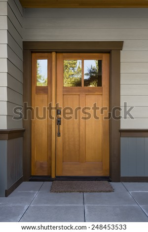 natural wood door at tiled...