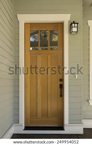 Natural wood front door with surrounding white door frame for Natural wood front door