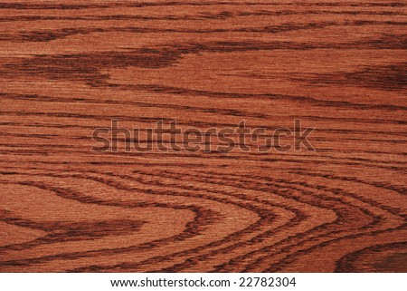 Natural wood grain design of oak wood with cherry stain finish.  Macro showing texture and details.