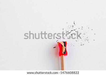 Natural wood pencil with red sharpener on the white surface.Conceptual image of education.