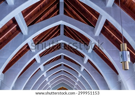 Natural wood roof and cement arched beams in an old abbey at the Monastery of the Holy Spirit in Conyers