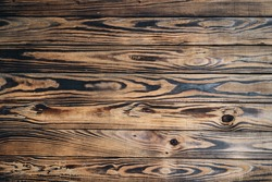 Natural wooden background with burned texture.