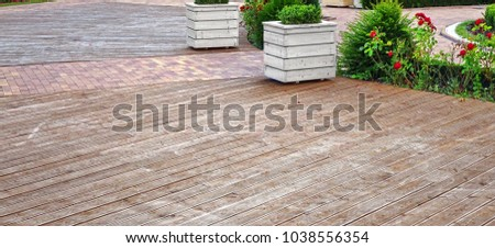 Natural Wooden Outdoor Decking. Summer Hardwood Patio Floor. Outdoor Dancing Flooring. Beach Walkway. Background. Texture. Abstract Web Banner.
