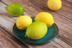 natural yellow lemon fruit on decorative plate