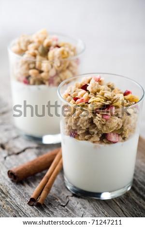 Natural yogurt with muesli in small glass