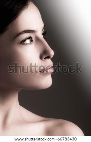 natural young woman beauty portrait, profile, studio shot