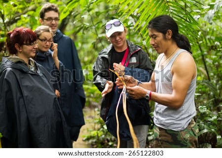 Naturalist Local Guid With Group Of Tourist In Cuyabeno Wildlife Reserve Ecuador