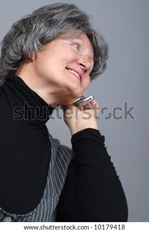 Naturally beautiful older woman talking on a cell phone