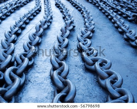 Naturally blue toned ship chains on the dock. - stock photo
