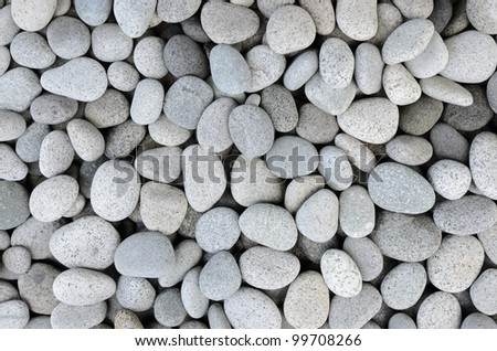Naturally polished white rock pebbles background