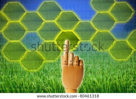 Nature and Technology in concept of saved green, wooden finger pressing on leaf button