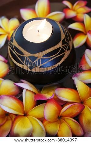 nature aromatheraphy treatment with frangipani flower - stock photo