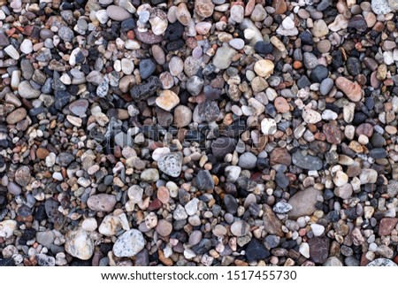 Nature background from sea pebbles. Pebble stone background