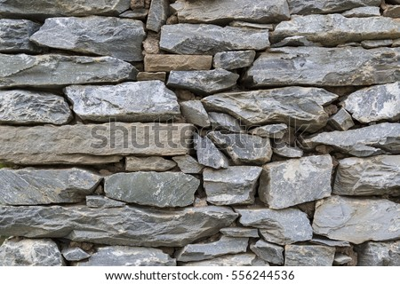 nature background of stone wall with different size and color  #556244536