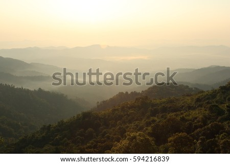 Nature  backgrounds /Dramatic clouds with mountain and tree: Mountain forests in Myanmar. #594216839