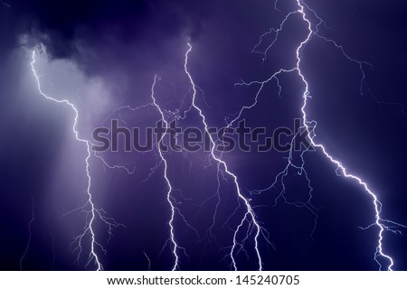 Nature force background - dark stormy sky with lightnings
