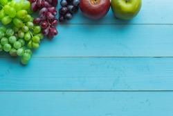 nature fruits set on blue wooden background