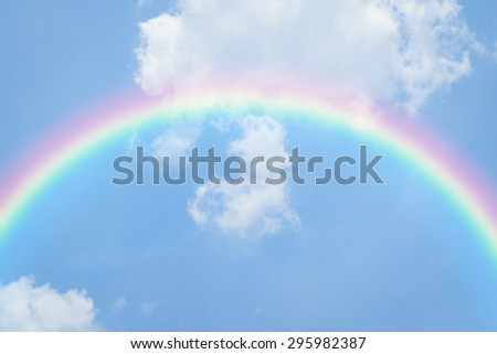 Nature heart cloudscape with blue sky and white cloud with rainbow