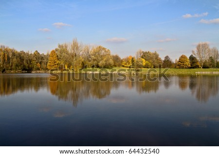 Nature in autumn with reflection in lake.