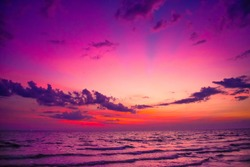 Nature in twilight period, Sunrise or Sunset over the sea. Sea view from tropical beach with purple sky. Summer beach with blue sea water and purple sky. Sea-scape scene with sunset landscape.