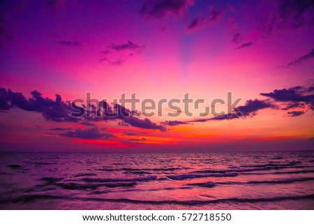Nature in twilight period, Sunrise or Sunset over the sea with beach chair. Sea view from tropical beach with purple sky. Summer beach with blue sea water and purple sky.  Vintage retro sea scape