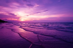 Nature in twilight period which including of sunrise over the sea and the nice beach. Summer beach with blue water and purple sky at the sunset.