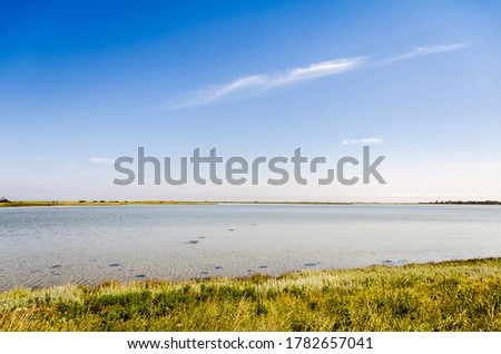 Nature landscape of Fyns hoved in Denmark with blue sky, clear ocean and islands in the water. Stockfoto ©