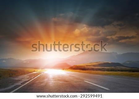 Nature landscape of sunset light above asphalt road #292599491