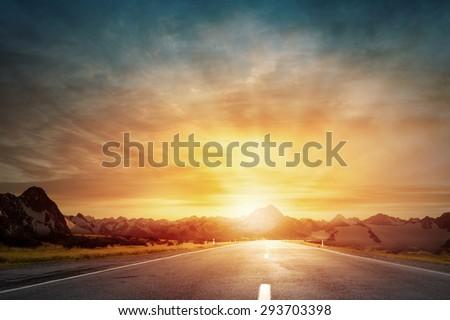 Nature landscape of sunset light above asphalt road